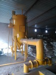 Dust extracting system with vibrating screen.