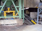 Silo discharge through reversible conveyor for two different applications.
